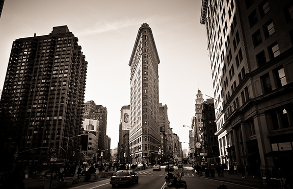 The Flatiron Building is seen in monochromatic view in New York City.